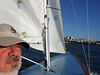 """Stephen Somerstein on deck - Sailing on San Francisco Bay on Ron Young's classic wooden boat """"Youngster"""""""