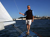 """Ron Young checking our windage - Sailing on San Francisco Bay on Ron Young's classic wooden boat """"Youngster"""""""
