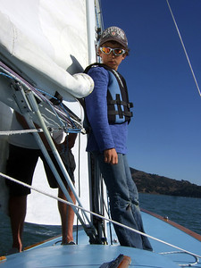 "Marc Lambros' son Silas, setting sails - Sailing on San Francisco Bay on Ron Young's classic wooden boat ""Youngster"""