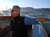 """Ron Young on tiller - Sailing on San Francisco Bay on Ron Young's classic wooden boat """"Youngster"""""""
