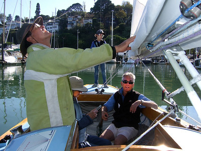 "Left, Marc Lambros; 2nd left, Lady friend of Ron Young; 3rd left, Marc's son; Right, Ron Young - Sailing on San Francisco Bay on Ron Young's classic wooden boat ""Youngster"""