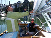 """Left, Marc Lambros; 2nd left, Lady friend of Ron Young; 3rd left, Marc's son; Right, Ron Young - Sailing on San Francisco Bay on Ron Young's classic wooden boat """"Youngster"""""""