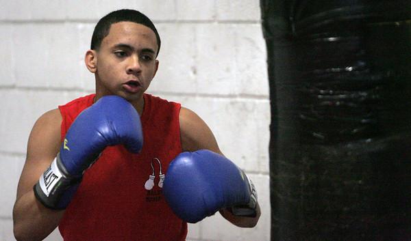 KEN YUSZKUS/Staff photo. Salem High boxer Erik Leibowitz practices in the school gym.  12/17/14