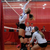 CARL RUSSO/Staff photo. Salem High School defeated Dover in tournament volleyball action. Salem's Brianna Wojtas spikes the ball over the net.  10/31/2012.