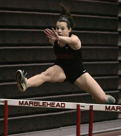 KEN YUSZKUS/Staff photo. Marblehead's Carlyn McGrath wins her heat in the girls hurdles during the Salem at Marblehead boys/girls indoor track meet.   12/12/14