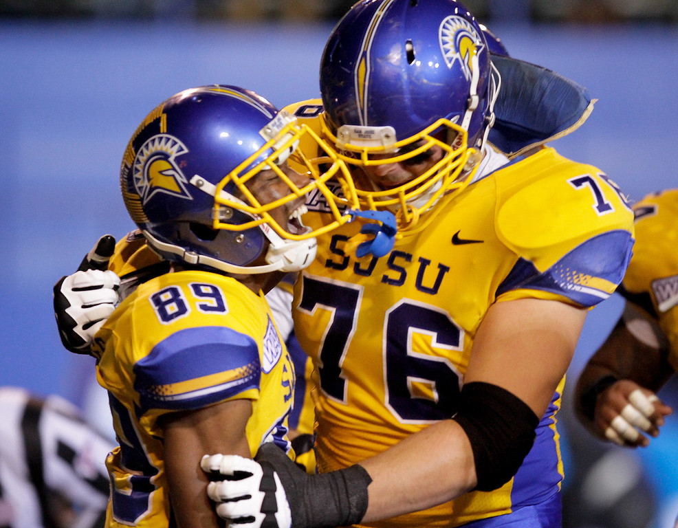 San Jose State Spartans wide receiver Chandler Jones (89) celebrates his touchdown with offensive tackle David Quessenberry (76) in their game against Brigham Young in the first quarter of an NCAA college football game in San Jose, Calif., Saturday, Nov. 17, 2012. (AP Photo/John Storey)