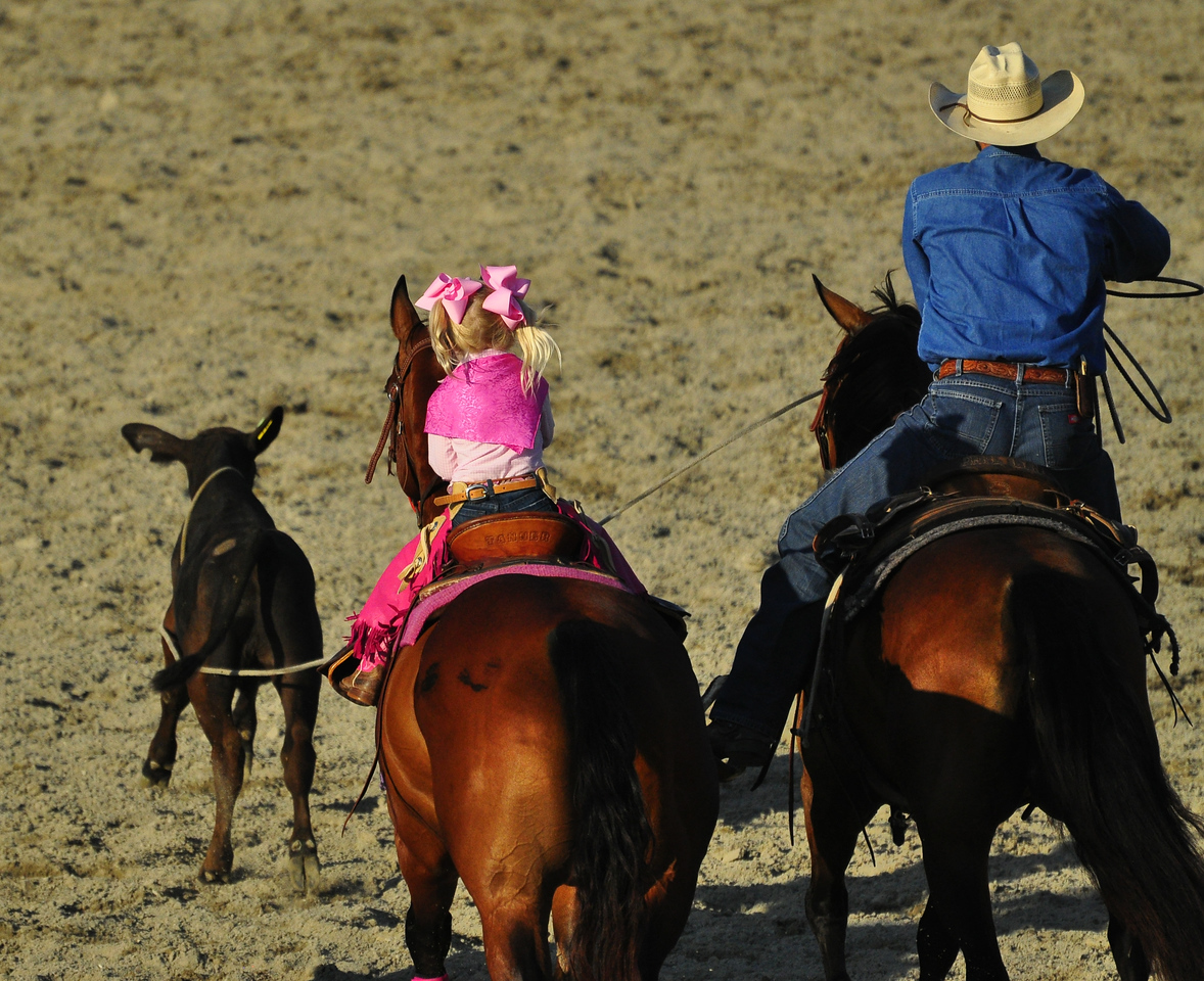 Cowgirl calf roping