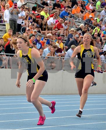 -Messenger photo by Britt Kudla<br /> Vanessa Dodds (right) of Bishop Garrington prepare to make the hand off to teammate Johanna Vaske during Class 1A Sprint Medley on Saturday