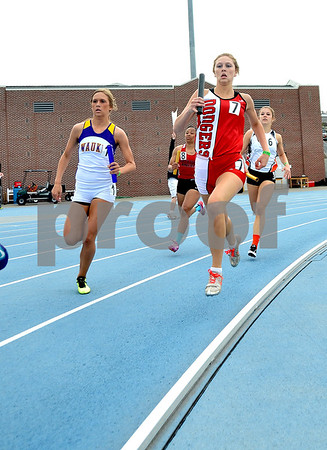 -Messenger photo by Britt Kudla<br /> Lexi Astor of Fort Dodge finish the last lap of the 800 Sprint Medley on Saturday at Drake stadium