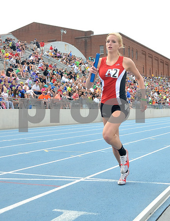-Messenger photo by Britt Kudla<br /> Tatum Meyer of Algona takes take the last lap in Class 3A Sprint Medley at Drake Stadium. Algona girls finish with a time of 1:55.35 on Saturday