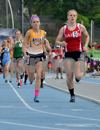 -Messenger photo by Britt Kudla<br /> Tiffany Christensen of Eagle Grove chases down Saint Ansgar's Natalie Halfman with Megan Flattery of St. Edmond in tow, during the final lap of the 2A 800 Meter Run on Saturday. Tiffany finish with a time of 2:15.07 for third place at Drake Stadium
