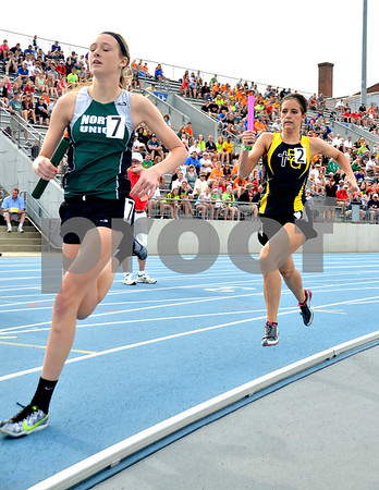 -Messenger photo by Britt Kudla<br /> Aisha Miller of Bishop Garrington chases down North Union's Olivia Marlow during the final lap of Class 1A Sprint Medley on Saturday
