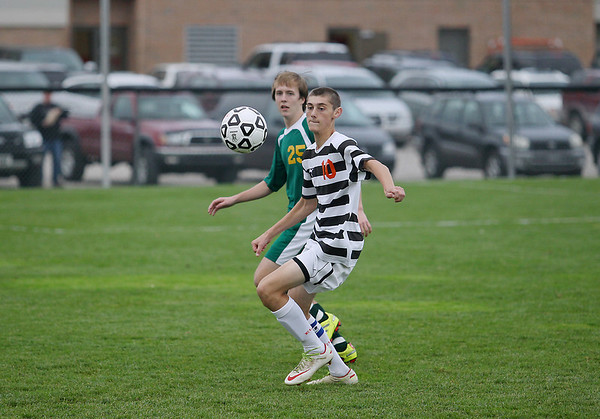 Record-Eagle/Keith King<br /> Elk Rapids' Kam Johnson (10), right, goes after the ball against Comstock Park's Jordan Lindsey (25) Tuesday, October 23, 2012 at Elk Rapids High School.