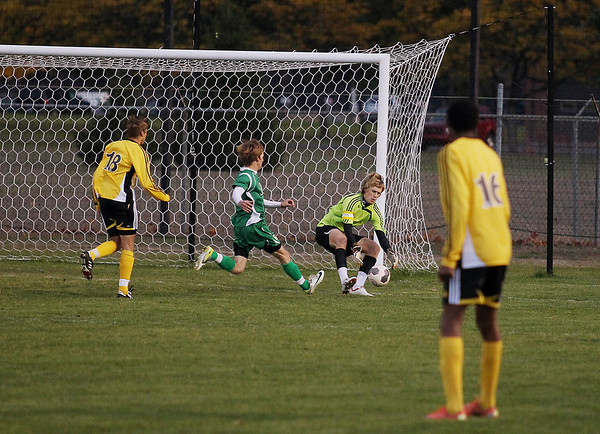 Record-Eagle/Keith King<br /> Traverse City Central goalkeeper Colin Lesoski recovers the ball against Alpena Thursday, October 18, 2012 at the Coast Guard Field in Traverse City.