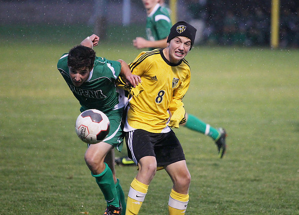Record-Eagle/Keith King<br /> Traverse City Central's Grant Dulude, right, and Alpena's Peter Guest battle for control of the ball Thursday, October 18, 2012 at the Coast Guard Field in Traverse City.