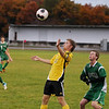 Record-Eagle/Keith King<br /> Traverse City Central's Charlie Needham eyes the ball against Alpena's Bret Letourneau, right, Thursday, October 18, 2012 at the Coast Guard Field in Traverse City.