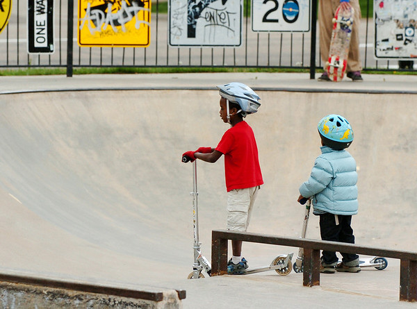Abi Sjong, 7,  left, and his brother, Zuru, 3, wait for the big kids before riding the bowls at Scott Carpenter Park on Thursday.<br /> Cliff Grassmick / May 13, 2010