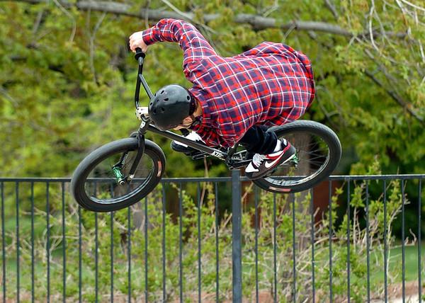 Matthew Meyer gets some air on his bike at Scott Carpenter Skate Park on Thursday.<br /> Cliff Grassmick / May 13, 2010