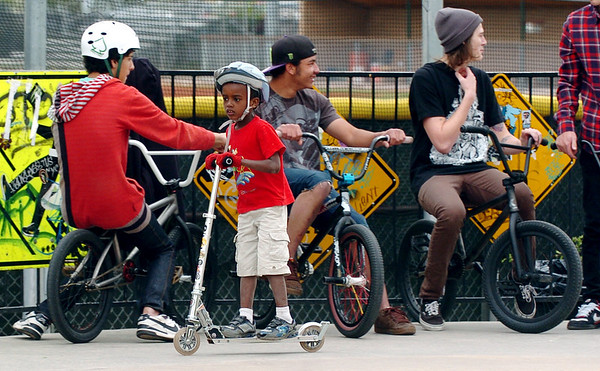 Abi Sjong, 7, rides past the big boys at Scott Carpenter Park  on Thursday.<br /> Cliff Grassmick / May 13, 2010