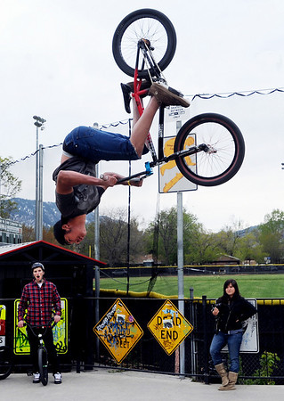 Jordan Greene performs a series of bike tricks at Scott Carpenter Park on Thursday.<br /> Cliff Grassmick / May 13, 2010