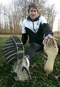 Cross country feature on Scott Snyder.  He's one of few people who ran in the original LCCC turkey trot Thanksgiving day run.  He shows off one of his British-made Gola Cross-country spikes (right) that he wore at Baldwin Wallace during his college days and even to a few of the Turkey Trots.  They 'pulverized' around 1982 or 1983.  photo by Chuck Humel