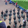 Pipe band escort the famous trophy.
