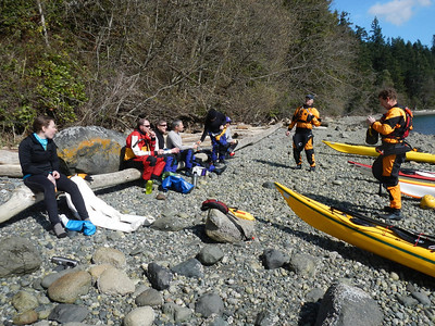 Lunch and class instruction. Note Alex drying her drysuit after inadvertently leaving a zipper open.