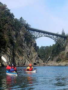 Eric and Tina with the Deception Pass bridge over Canoe Pass in background.