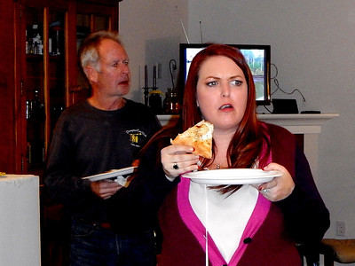 Mark is still in shallow thought while Linda expresses how wonderful the white chicken pizza is