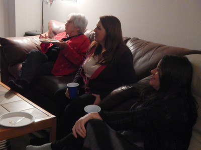 Sue, Linda, and Tina watching Mike's video on TV