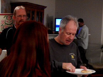 Phil Boyd and Linda watch Mark eat his pizza
