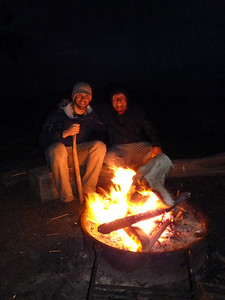 Brian  and Oskar warming by the camp fire
