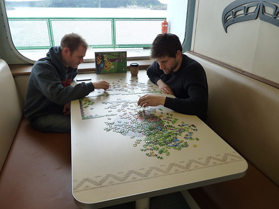 Brian and Daniel working on a puzzle on the ferry ride back to Anacortes
