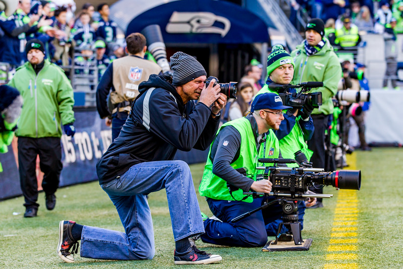 Randy Johnson taking pictures during the Seahawks game