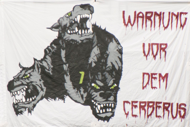 """Fan banner, draped over the rails at the North end.  """"Beware Cerberus"""" (roughly translated)."""