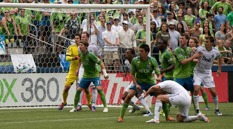 Rave Green and Northern White battle in the box on a Whitecaps set piece.