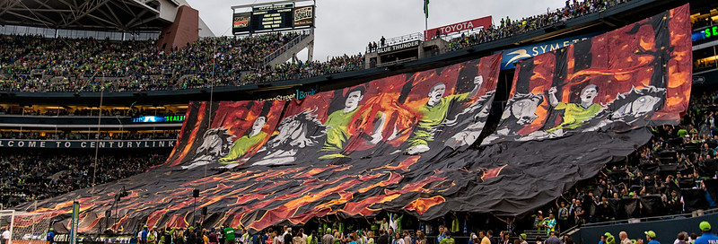 "Seattle's Tifo - ""Build a Bonfire"" (refers to the chant: ""Build a bonfire, build a bonfire - put the Timbers on the top! Put the Whitecaps in the middle, and we'll burn the bloody lot!"""