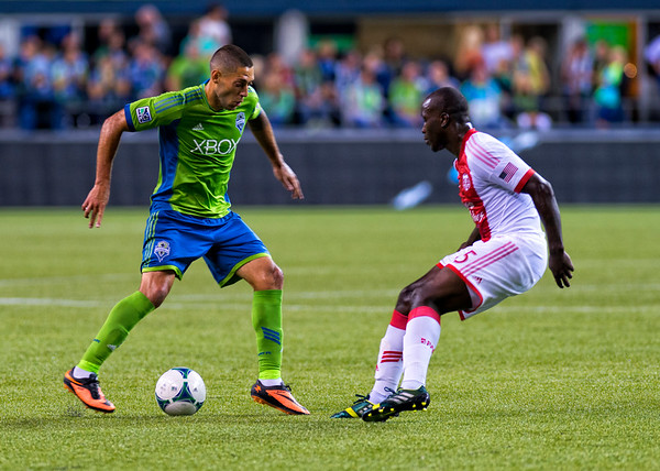 Clint Dempsey works to fake out a Timber