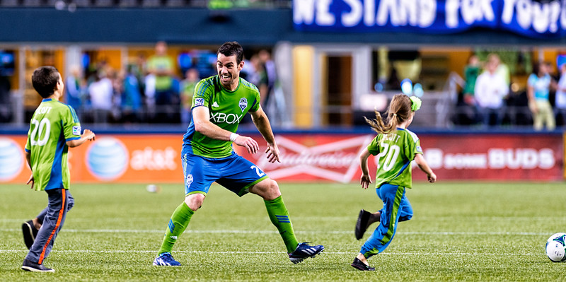 Zach Scott - Post-game play time.  Zach Scott relaxes after the match by playing around with his kids.