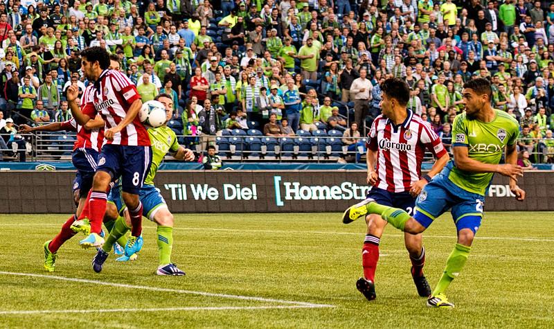 Neagle flicks the ball toward Scott.