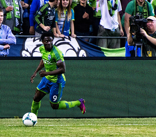 Obafemi Martins just manages to stop the ball from crossing the line.