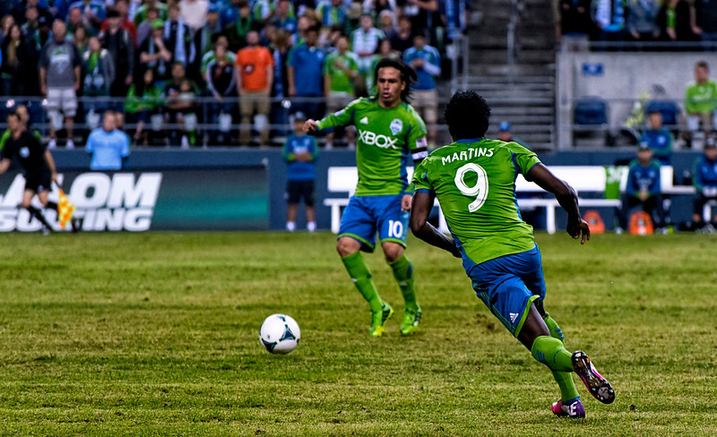 Obafemi Martins receives the pass from Mauro Rosales, and starts a run into the box