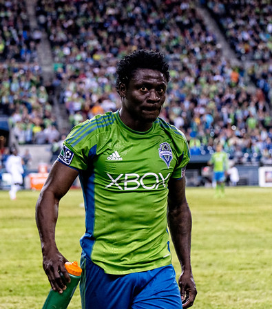Obafemi Martins walks to the sidelines - unhappy, and angry.