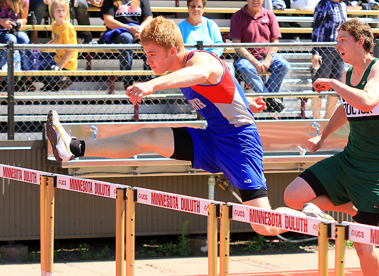 Moose Lake/Willow River's Michael Pender competes in the 110 meter hurdles at the Section 7A Championships at UMD on Friday.  Pender won the section championship with Esko's Jordan Tucker finishing second.