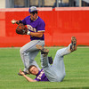 6-2-14 --  Sectional Baseball Finals Northwestern vs West Lafayette HS with Northwestern winning. Austin Bowley backs up SS Quinlan Armstrong who dove for the ball behind second base in the 4th inning.  ---<br /> Tim Bath   Kokomo Tribune