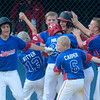 The Selinsgrove team surrounds Tyler Swineford after he hit a home run against Williamsport during the Little League All-Star Major Division final on Thursday in Minersivlle.