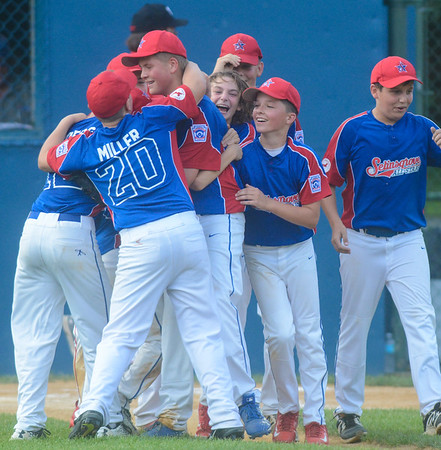 The Selinsgrove team runs in the infield to celebrate after defeating Williamsport for the Major Division Championship game on Thursday in Minersville.