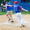 Selinsgrove's Jacob Anders chases down coach Cheri Swineford to splash water on her after winning the Major Division Championship on Thursday in Minersville against Williamsport.