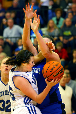 3-1-14  ---  Semi State girls basketball between Tipton and Canterbury. Tipton's Molly Mahaney runs into Canterbury's Katherine Smith while going in for a shot under the basket. -- <br /> KT photo | Tim Bath