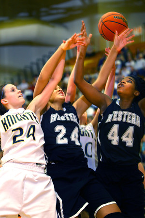 3-1-14  ---  Semi State girls basketball between Western HS and Norwell HS with western winning 41-31. Rebounding are Norwell's Stephanie Conrad and Western's Siera Daniel and Raven Black. -- <br /> KT photo   Tim Bath